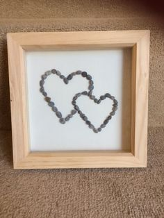 Double heart pebble picture. Perfect for loved ones/ engagement gift/ wedding gift. Names can be added if you want. Please note due to the nature of the craft, pebbles used may vary slightly from ones shown in the picture.