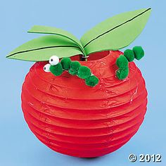 I used miniature lanterns and felt for the leaves.  Minus the worm.  For Ruby's Apple of my eye party.