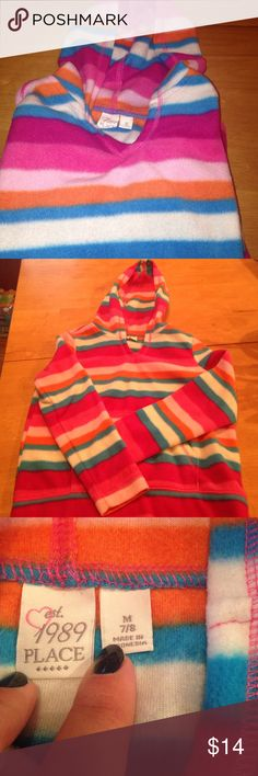 New! Childrens Place striped hooded pullover Super soft in shades of pink, orange, blue and white. Long sleeves with v neckline and kangaroo front pocket. Size is Medium7/8. 100% poly. Children's Place Shirts & Tops Sweatshirts & Hoodies