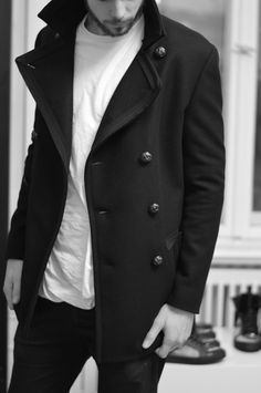 A man in a nice coat no matter how scruffy is infinitely more attractive :)