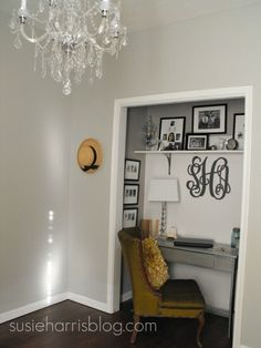 Desk in closet - add more shelves and filing cabinets below.  Love the paint color and chandy.