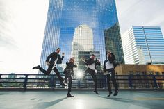 Groom and groomsmen jump shot on top of a parkade. Fun quirky shot, By Calgary wedding photographer Anna Michalska Photography. See more in the article link!