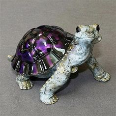 """Barry Stein bronze turtle sculpture Daden with jewel-like Black/Purple Patina Shell. Limited Edition of 1000 and approx. 6.9"""" l x 4.5""""h. Comes in a luxurious soft velvet & satin embroidered bag. Highly collectible with several other colors to build your collection."""
