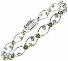 Sterling Silver Scattered Green CZ Bracelet LEAH HANNA. $24.99