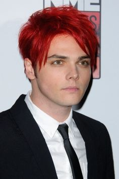 Gerard Way bright red hair. I couldn't find a picture of a girl with this color hair so I had to find a good picture of Gerard (witch wasn't that hard) with red hair so I can have an example for when I get my hair done sometime, you know, when no one can tell me no.