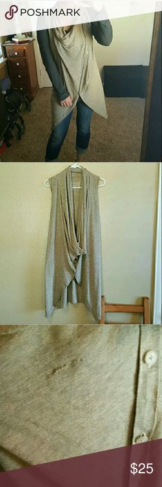 All Saints wrap sweater Soft silk and wool tightly made fabric. Sleeveless, can be worn and buttoned many ways in front and on shoulder. Small snag in last photo, hidden when styled certain ways. Size 10, but can be worn on many sizes with the style. Repost from cancelled order. NO TRADES All Saints Sweaters
