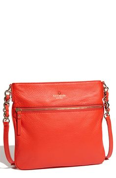 Great Kate Spade leather crossbody bag.  Great as an everyday bag, as well as, for going out.  Great size. Comes in Black, tan, white and some other colors.  This cinnabar color is great for the spring and summer!