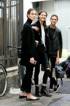 these gals proving that an all black outfit can have variety and interest!
