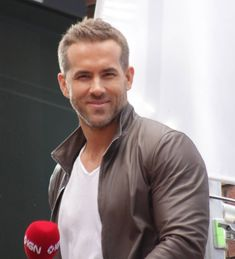 Ryan Reynolds has been named People magazine's Sexiest Dad Alive.The 39-year-old actor is father to daughter James, who turned one in December (15), with wife Blake Lively. His latest honour was revealed when he appeared on The Tonight Show starring Jimmy Fallon on Tuesday night (09Feb16), with host