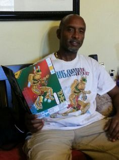 Author and Illustrator CJ JUZANG enjoying the new printed copy of ADIGUN OGUNSANWO™ - AKIL Ashcan as well as wearing his AKIL TSHIRT. Can be scooped up this weekend May 15, and 16, 2014 at the 14th ANNUAL EAST COAST BLACK AGE OF COMICS CONVENTION in Philadelphia, PA
