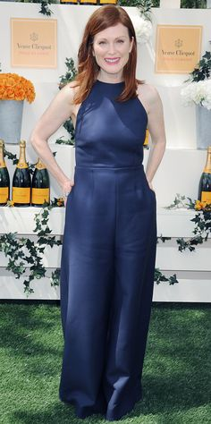 Julianne Moore worked the one-piece wonder at the Veuve Clicquot Polo Classic in a navy wide-leg Rosie Assoulin jumpsuit, leaving accessories to a minimum, save for delicate gold hoops and poppy pink lip.