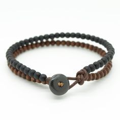 ◊ Mens stylish double strand beaded bracelet handmade with 4mm black and brown wooden beads and brown leather cord.  ◊ The bracelet features a bone bead