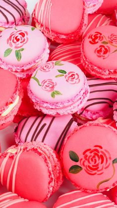 Pink macarons with painted roses
