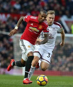 Ashley Young of Manchester United in action with Scott Arfield of Burnley during the Premier League match between Manchester United and Burnley at...