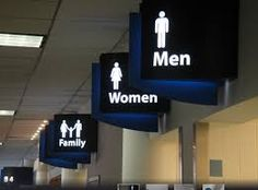 "Bathroom Signs Walmart we don't care"" (courtesy peregrine honig) 