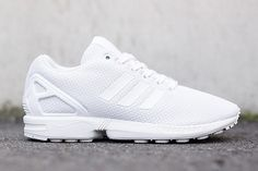 "adidas Originals has released a brand new pair of its ZX Flux runner model dubbed ""All White,"" serving as a perfect addition to one's ""winter white"" aesthetics. The sneaker utilizes the combination of..."