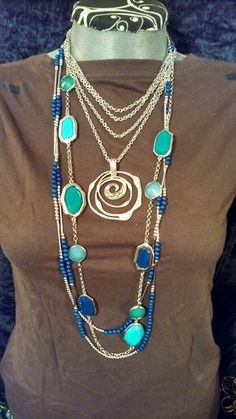 True Blue split and criss crossed with Silver Swirl Enhancer and Gemma layered long. Love it! Like my page https://m.facebook.com/jazzyjewelryjess