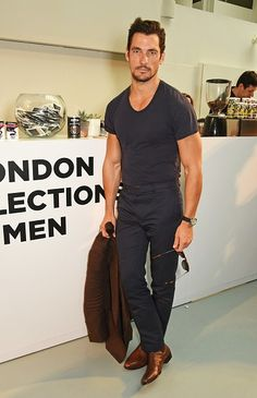Treat T-shirts Like Button-Downs Toggle | David Gandy's navy T-shirt clearly isn't the same one he wears to the gym; it isn't faded, it has a slim fit, and there's not a wrinkle in sight. It might feel weird to iron your T-shirt in the morning but, trust us, it'll separate you from the office slob.