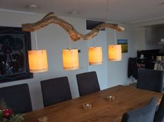 Plafondlamp van verweerd oud Eiken tak, prachtig bewerkt tot sfeervolle verlichting voorzien van 4 echt hout fineer lampenkappen. Lengte 140 cm. Kijk op made by GBH NatureArt. Www.etsy.com/people/gbhnatureartnl