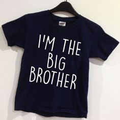 I M THE BIG BROTHER slogan tee popular with all little brothers Children s crew neck t-shirt printed to order T-shirt colour Navy or Black SIZE Age