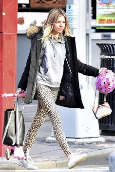 Sienna Miller wearing Woolrich Arctic Parka in Black, Adidas Stan Smith Sneakers, Proenza Schouler Large Hex Whipstitch Bucket Bag and Valentino Glam Lock Mini Striped Leather Shoulder Bag