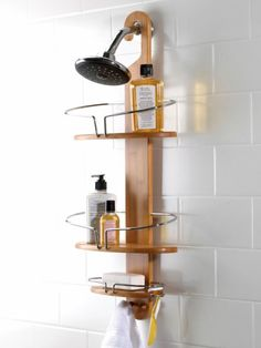 prettier than those silver ones - can hold it in place with a neutral colored rubber band wrapped around the top of the shower head.  works for me!  Eco-Chic Shower Caddy from bed bath and beyond $40.