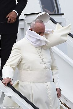The pontiff's skullcap was blown off by a gust of wind as he stepped off the plane at Havana's international airport this afternoon