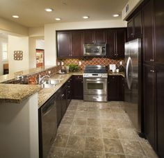 Linoleum Flooring Images: Faux Stone Linoleum Kitchen Floor With Multicolored Features