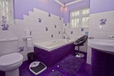 I found this on Rightmove.....just love the purple carpet up to the bath
