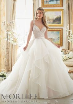 Morilee by Madeline Gardner | Style 2887 | Dazzling Beaded V Neck Bodice on Flounced Tulle and Organza Ball Gown Wedding Dress in Blush.  Delicate double straps.