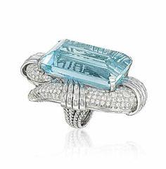 AN IMPRESSIVE AQUAMARINE AND DIAMOND RING