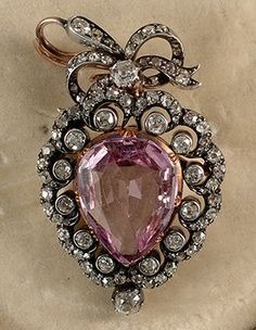 Victorian Gold on Silver brooch pendant with natural Russian Pink Topaz 9.5 carats surrounded by diamonds ca.1880