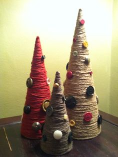 Cardboard trees wrapped with yarn and twine. I used my grandmother's old buttons to decorate.