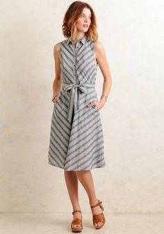 This darling striped dress is perfect for when you want to look chic and effortless. Designed in a denim-blue hue with diagonal cream-colored stripes that help add a classic finish to the dress. ...