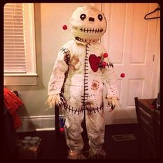 The Man spent a few weeks creating his costume - a very realistic voodoo doll, complete with pins.