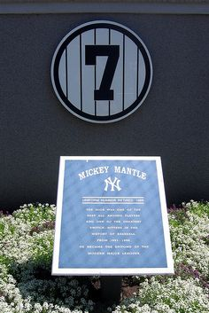 Yankee Stadium: Monument Park - Retired Numbers - Mickey Mantle #7 by wallyg, via Flickr