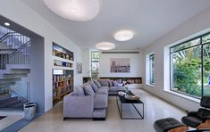 Its nice to see a living area not defined by the television.  The long pavilion style is also very elegant. Raanana House by Sharon Neuman Architects