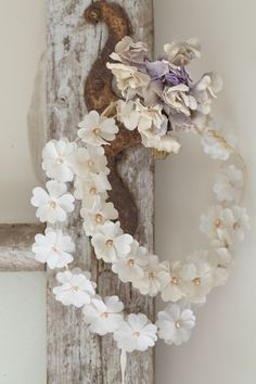 White wreath- bought a box of WILTON PETALS on amazon [$9.00?] , hot glued the petals in layers, glue any color pearl in center . can glue to round wire or use flowers as embellishments.