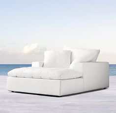 RH's Cloud Track Arm Outdoor Chaise:Entirely modern in outlook, designer Timothy Oulton has reimagined his indoor seating collection for the outdoors. Classic track arms and a low frame play clean-lined counterpoint to cushions constructed of quick-dry foam that offer an ultra-relaxed sit with cloud-like comfort.