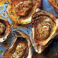 Grilled Oysters | The secret to this dish, a chargrilled homage to Gulf oyster houses, is a knockout garlic-herb butter.