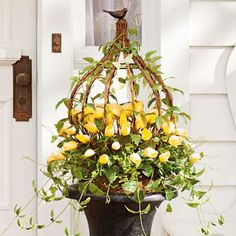 Put a fresh new face on your home with the look of professionally designed foliage that never needs watering, with our Tulip Urn Filler and Wreath.            Urn Filler is an abundance of lifelike pink tulips and cascading spring vines entwined among a sculptural metal and twig arbor                A delightful brown resin bird perched at the top brings it all to life                Wreath is the same mix of foliage, with even more tulips, perfect for adorning a door or window     Insert...