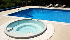 Rectangular Swimming Pool Design and Spillover Spa in Cincinnati by SunSpot Pool u0026 Patio Swimming & SunSpot Pool u0026 Patio (sunspotpools) on Pinterest