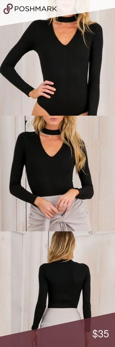 Ribbed Choker Neck Bodysuit in Black The ultimate on-trend look for fall! A super soft ribbed bodysuit with cut out choker neckline and hidden back zipper. Small and medium available. Boutique brand, new without tags. ✨Price Is Firm On Boutique Items✨ Boutique Tops