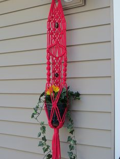 "Macrame plant hanger, RASPBERRY, 34"", 6mm poly cord, hanging planter, unique pattern, 2 wood beads, hippy, hippie, small, handcrafted, retro, $20.00"