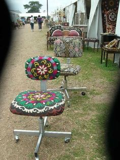 Desk chairs upholstered in vintage turkish cloth.  Love it!