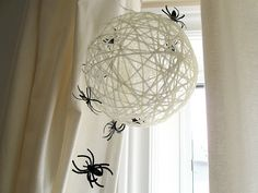 Spider nest made with yarn, glue & a balloon.