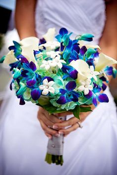 Blue orchids, Aqua hydrangeas, white calla lilies, and silver ribbon with rhinestones