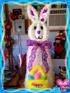 Another Bunny I made from a tomato cage.. White garland bunny face from Dollar Tree, plus lights