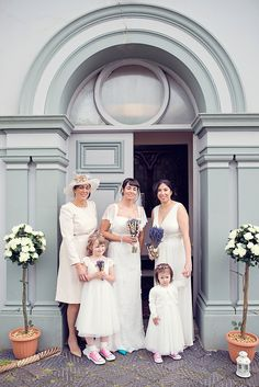 Bridesmaid (on right) wears a white Tiffany Rose gown | Photography by http://www.smithimaging.co.uk/