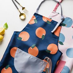 This fun and comfortable apron will keep your clothes clean while you get to work in the kitchen. Find more unique kitchen linens at Apollo Box! Apollo Box, Kitchen Linens, Lasagna, Gifts For Mom, Apron, Ties, Household, Essentials, Cookies